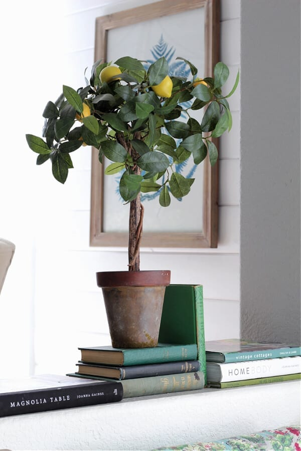 A lemon topiary and green books add that pop of color for Spring decor!
