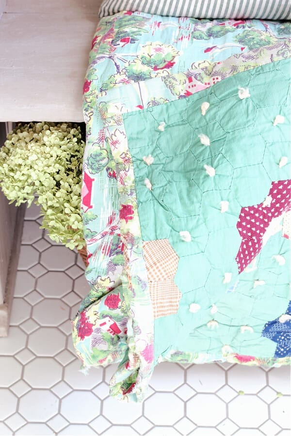 A green double sided vintage quilt adds Spring perfection tour entry.