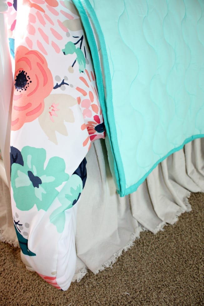 Drop cloth bed skirt in the shared girls room makeover.