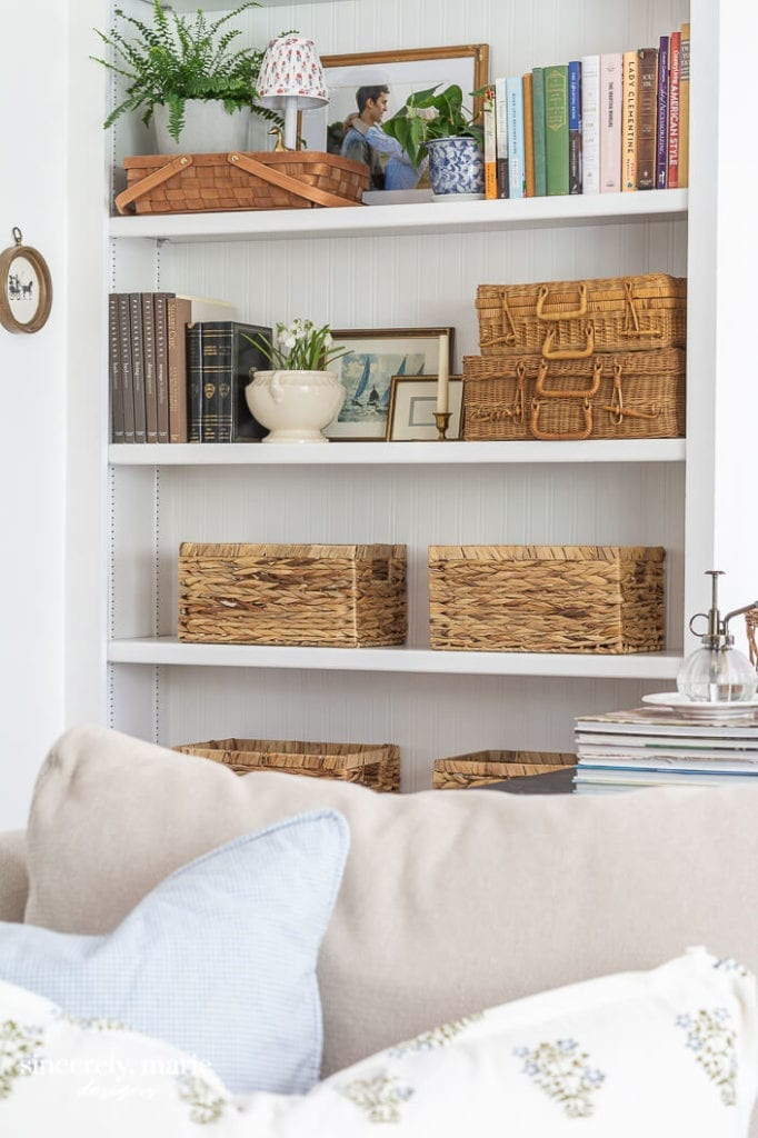 Welcome Home Sunday: Bookshelf with beadboard wallpaper.
