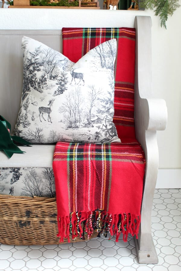 pillows and plaids make this Christmas decor cozy and collected.