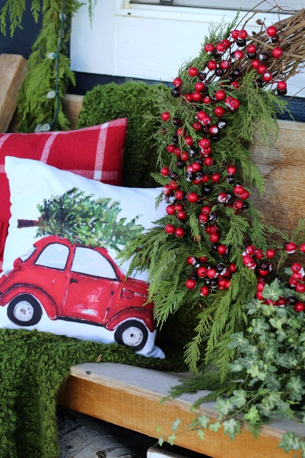 Cozy, collected and charming Christmas porch decor.