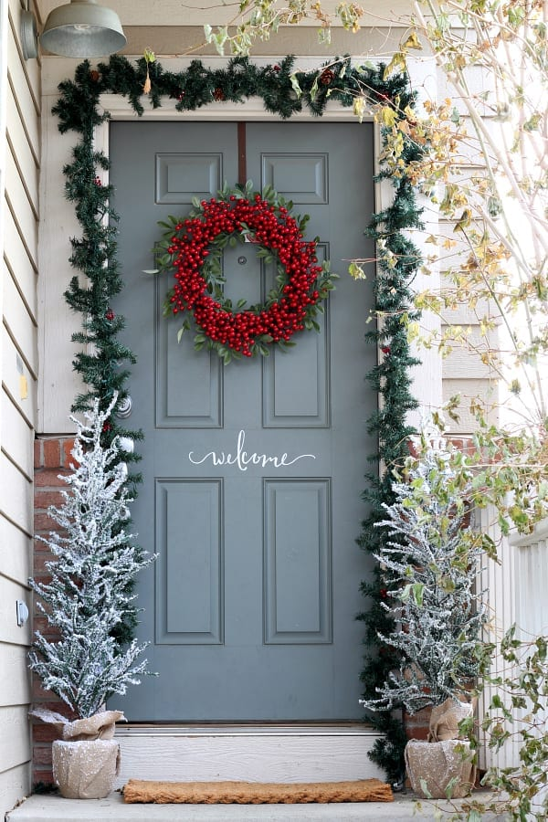 Red berry wreaths make for a welcoming statement on the Christmas porch.
