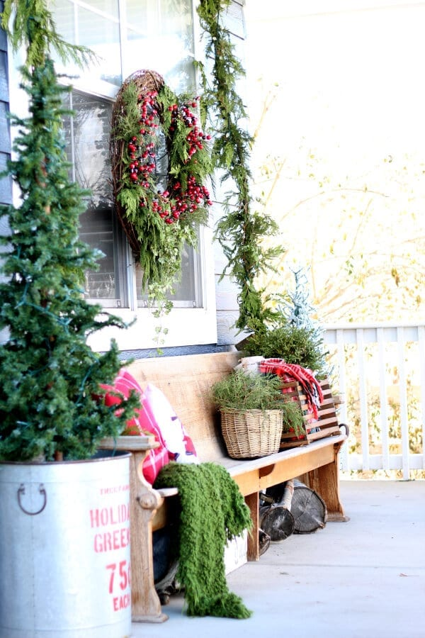 A cozy, collected and charming look at Christmas on the porch!