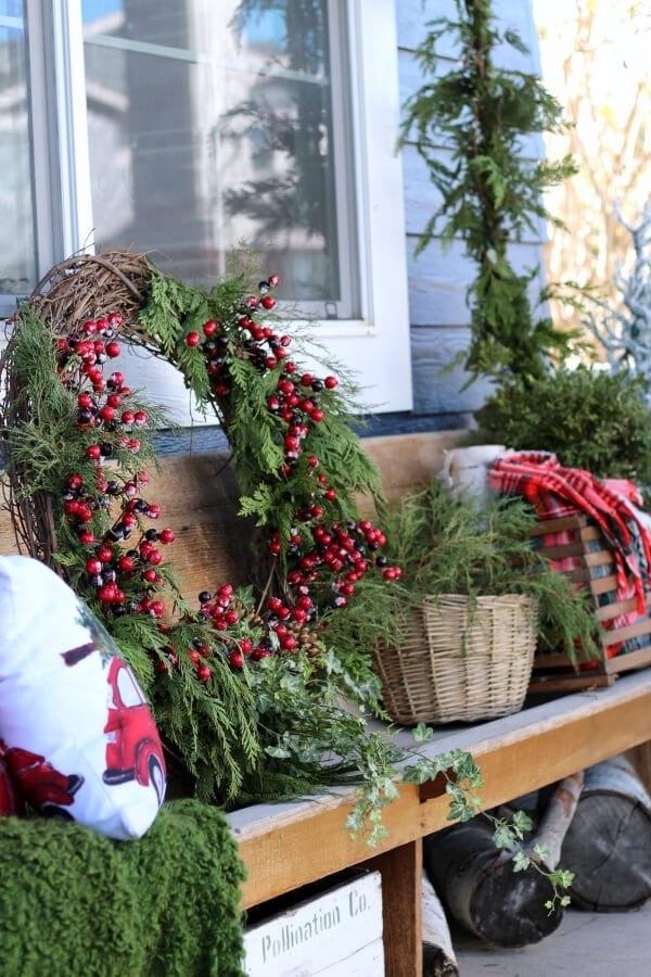 Christmas on our porch means large wreaths and fresh greenery!