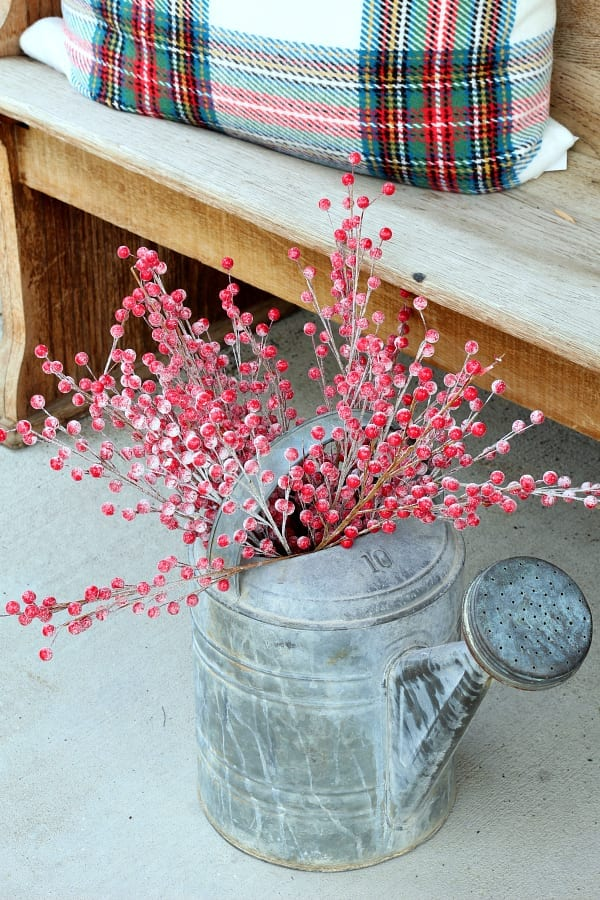 Christmas on the porch means flea market finds and red berries.