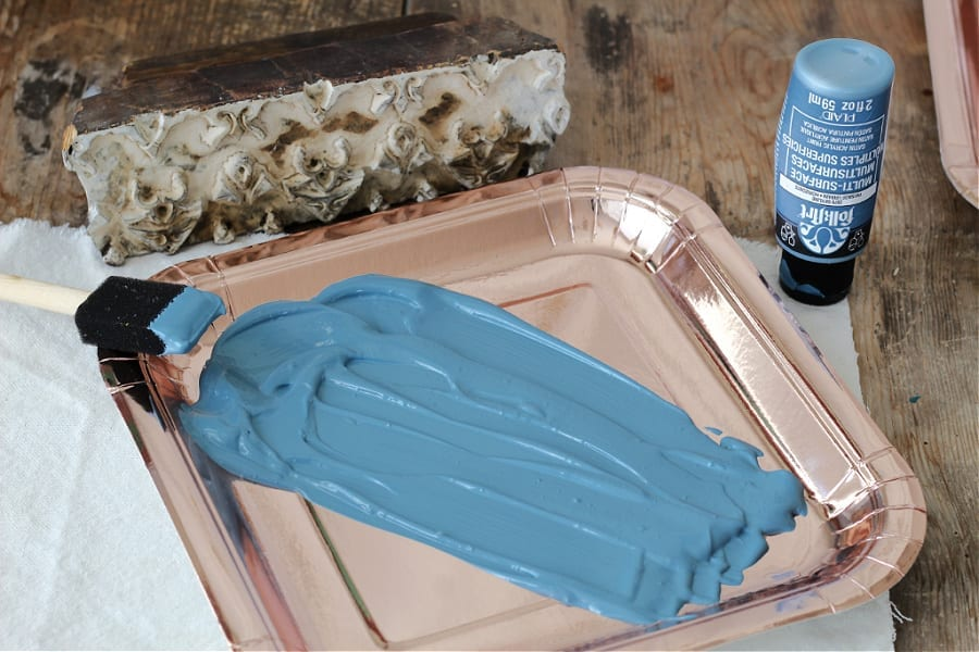 Pretty blue paint for block printing onto drop cloth napkins.