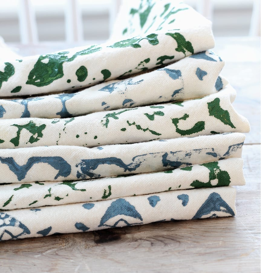 A stack of drop cloth napkins with DIY block print patterns