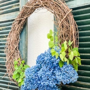 Make this blue hydrangea wreath in just minutes using spray paint!