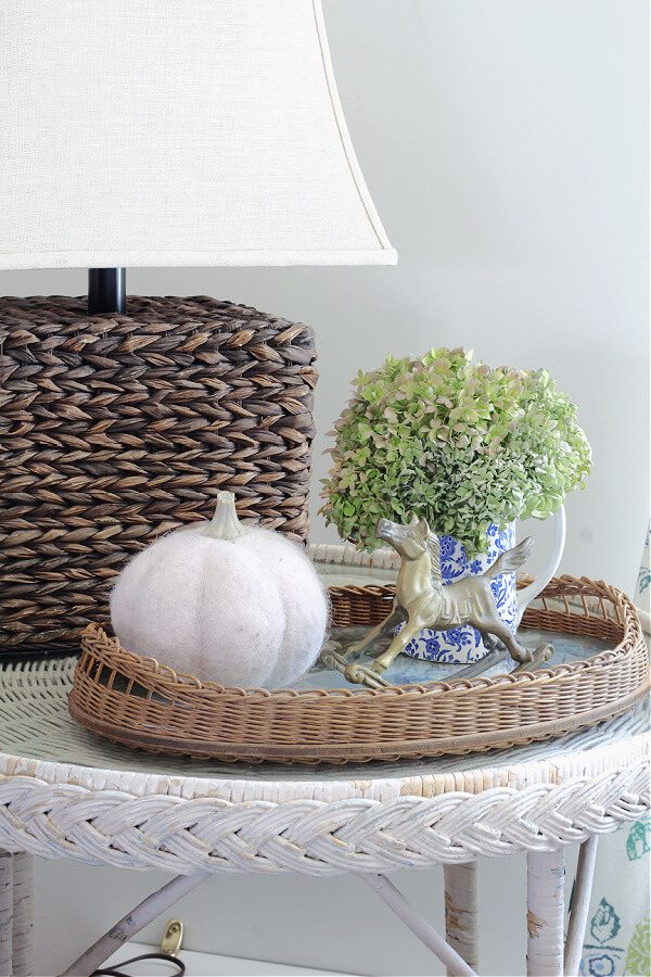 A Fall vignette with hydrangeas, pumpkins and brass.
