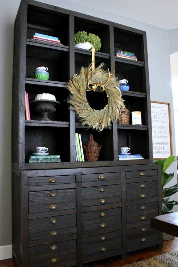A fall wheat wreath graces this print makers cabinet.