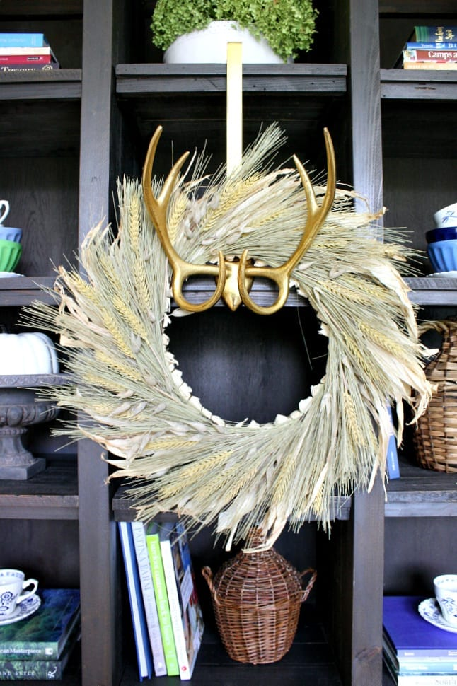 Gold antlers wreath hanger holding my favorite wheat wreath.
