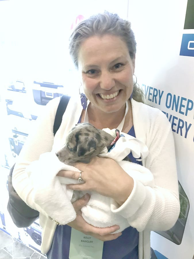 Haven 2019 holding a puppy at the Hoover booth