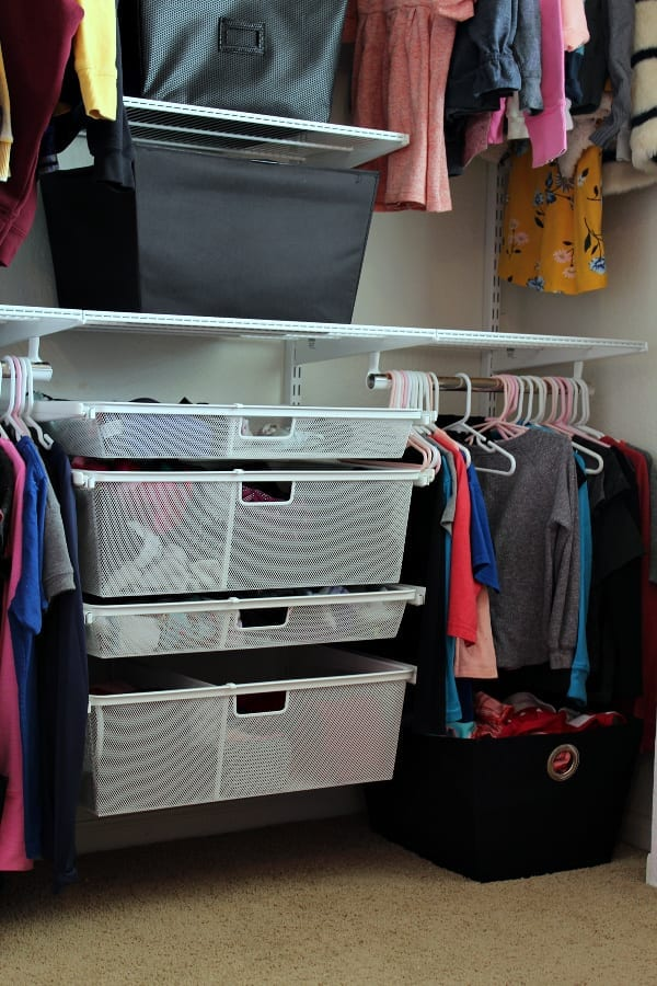 organized drawers and clothes in shared closet