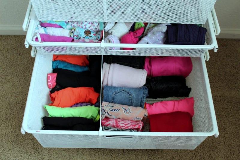 Organized drawers in kids closet.