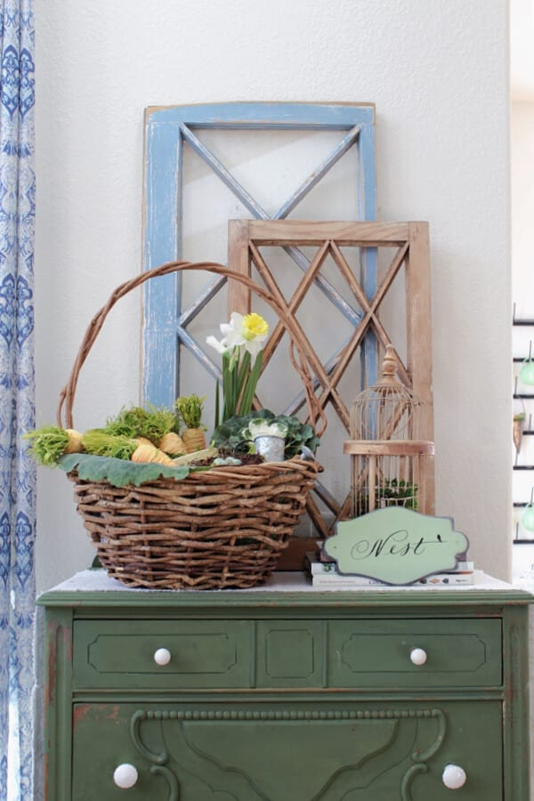 Easter basket and Spring decor make the perfect vignette