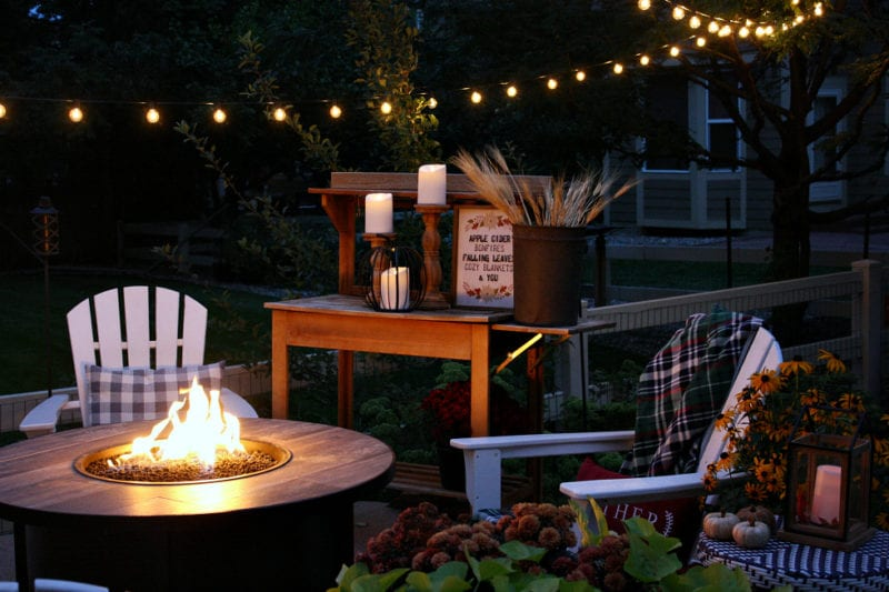 Fall outdoor decor featuring lights and lanterns.
