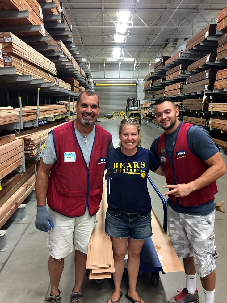Me at Lowes with the guys who helped me cut the shiplap.