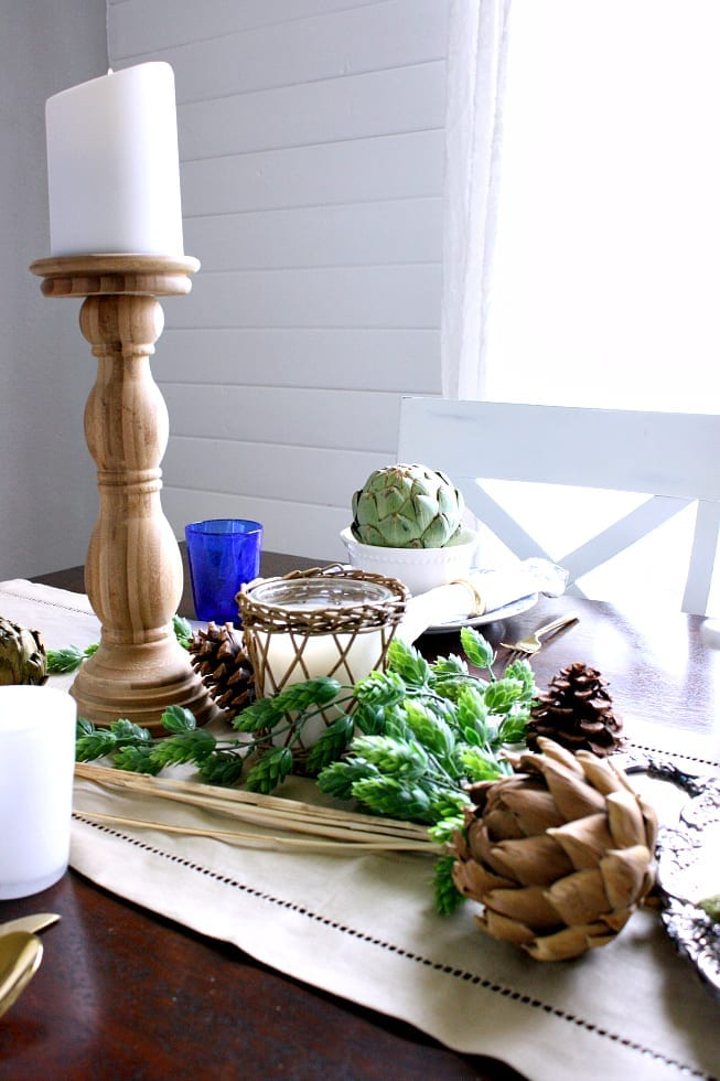 Candlesticks and greenery make this table perfect for Autumn.
