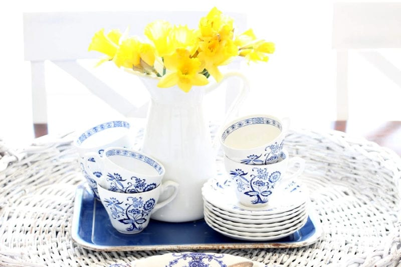 yellow daffodils and blue and white tea cups