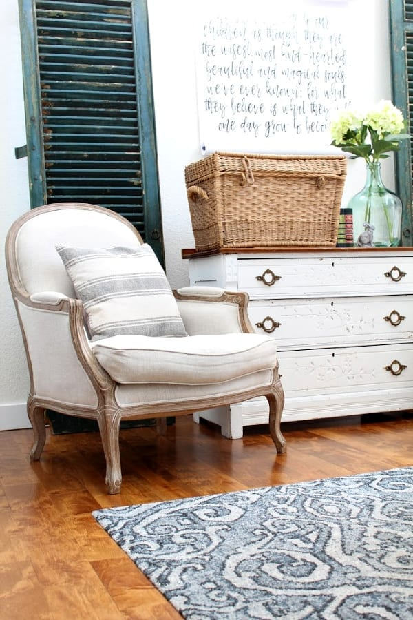 This chair, dresser and basket are dressed up for Spring.