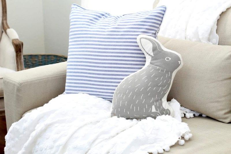 Rabbit pillow on sofa.