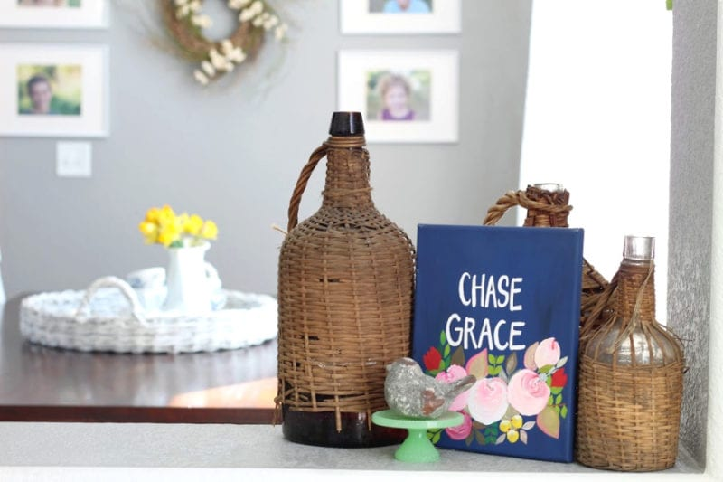 Chase Grace sign and wicker demi johns the perfect and practical Spring combo