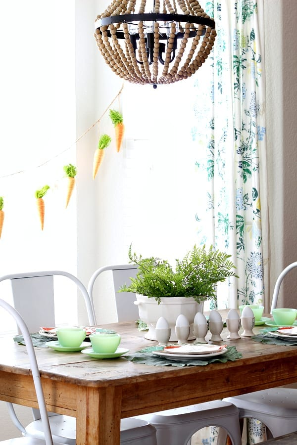 A sweet little Easter tablescape featuring jadeite and Rae Dunn.