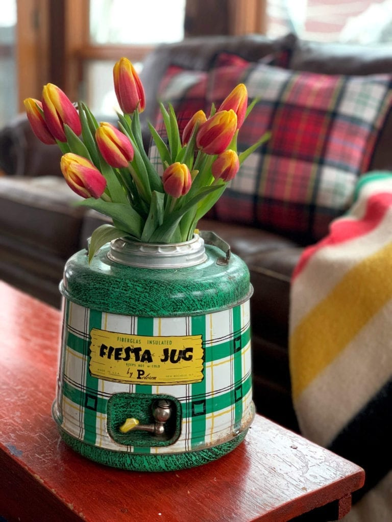 Welcome Home Sunday: Creative ways to use vintage containers as vases.