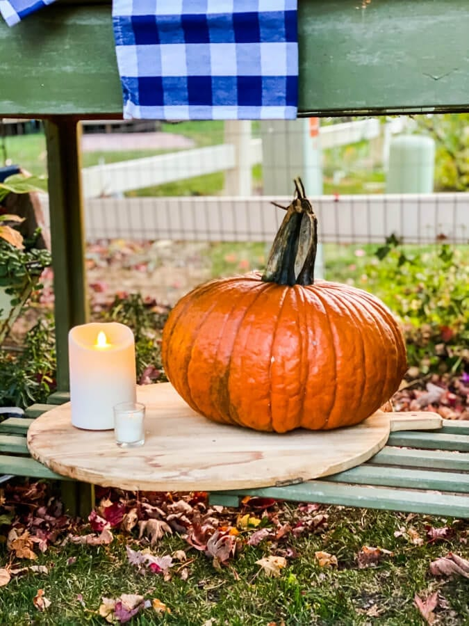 Pumpkins, plaid and candles in the Fall garden.