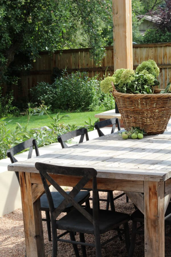wooden outdoor table with black chairs.