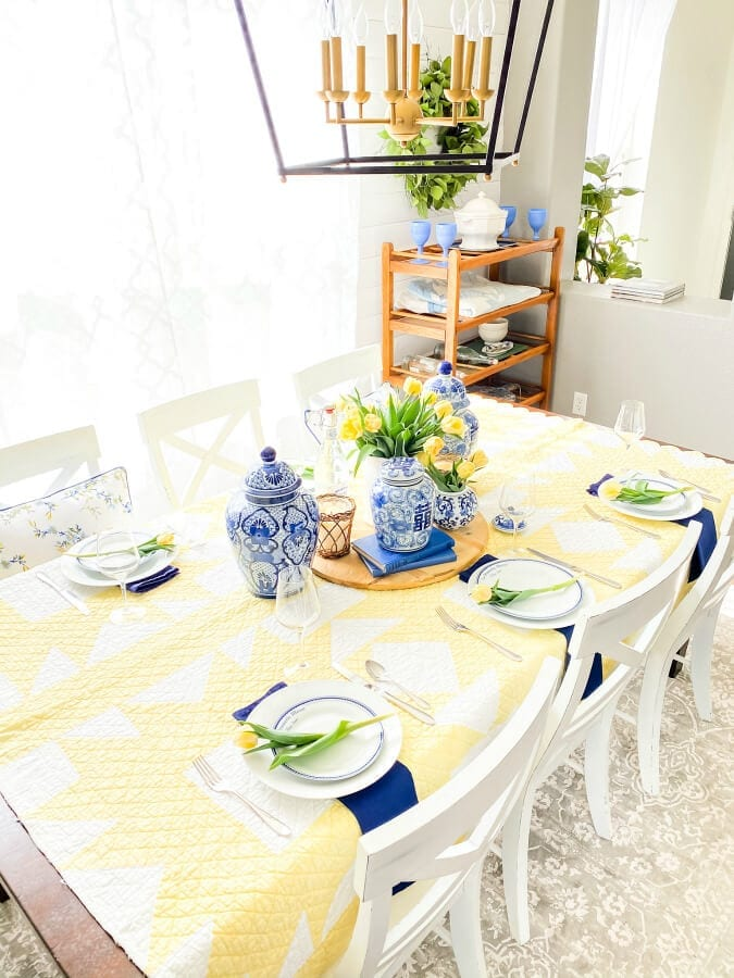 A blue and yellow Mother's Day tablescape.