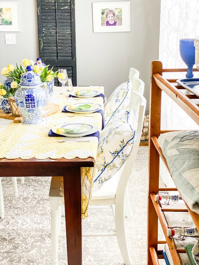 A vintage quilt add the perfect pop of yellow to this Mother's Day table.