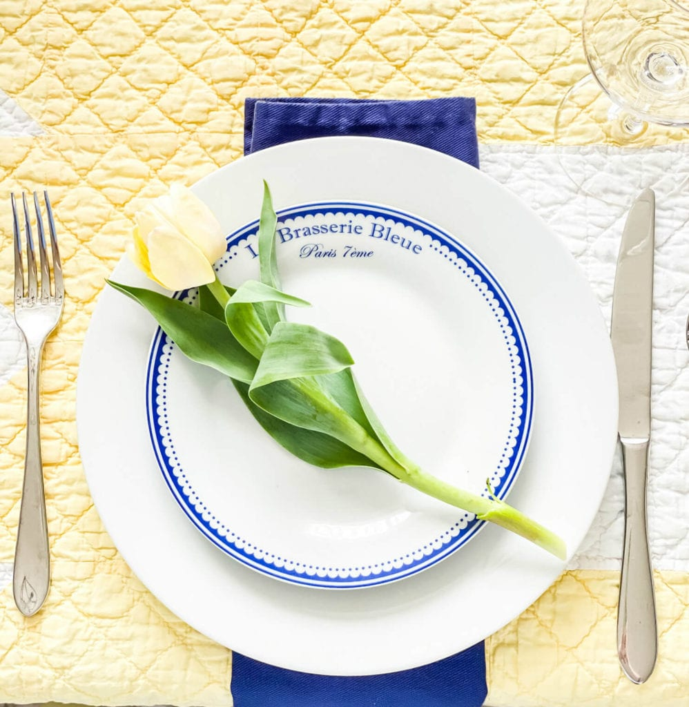 These blue and white plates look pretty with a single tulip added for a fun pop of color!