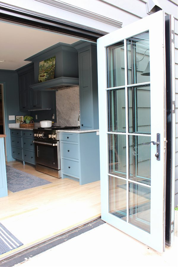 Trifold doors in our kitchen leading to our backyard!
