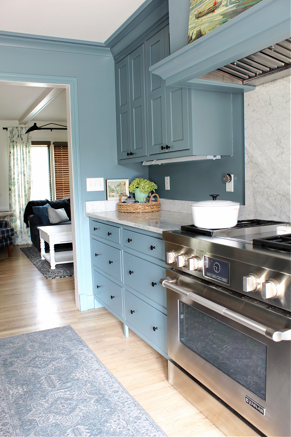 Our kitchen with Distance blue cabinets by Sherwin Williams.