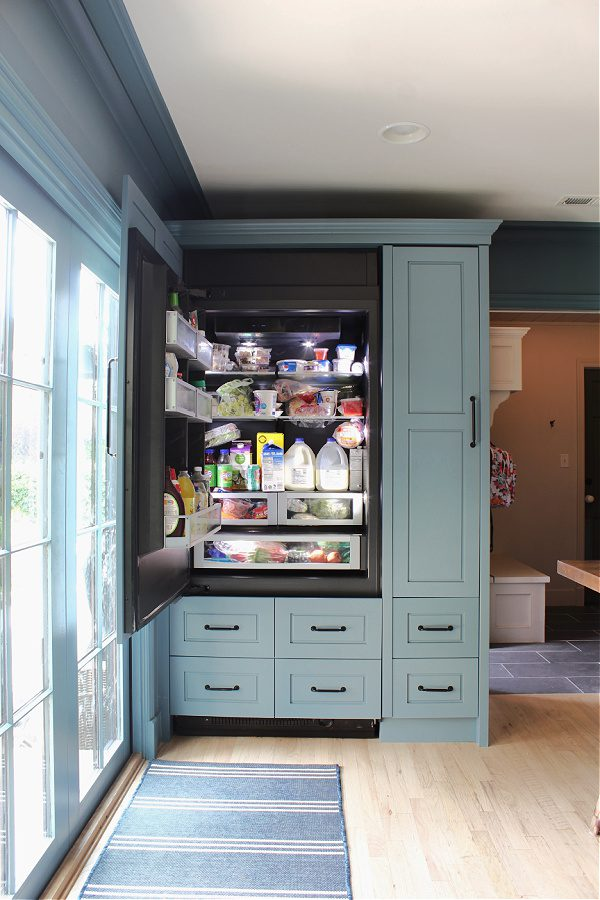 Integrated appliances in our all blue kitchen! Love how the refrigerator looks like cabinets.