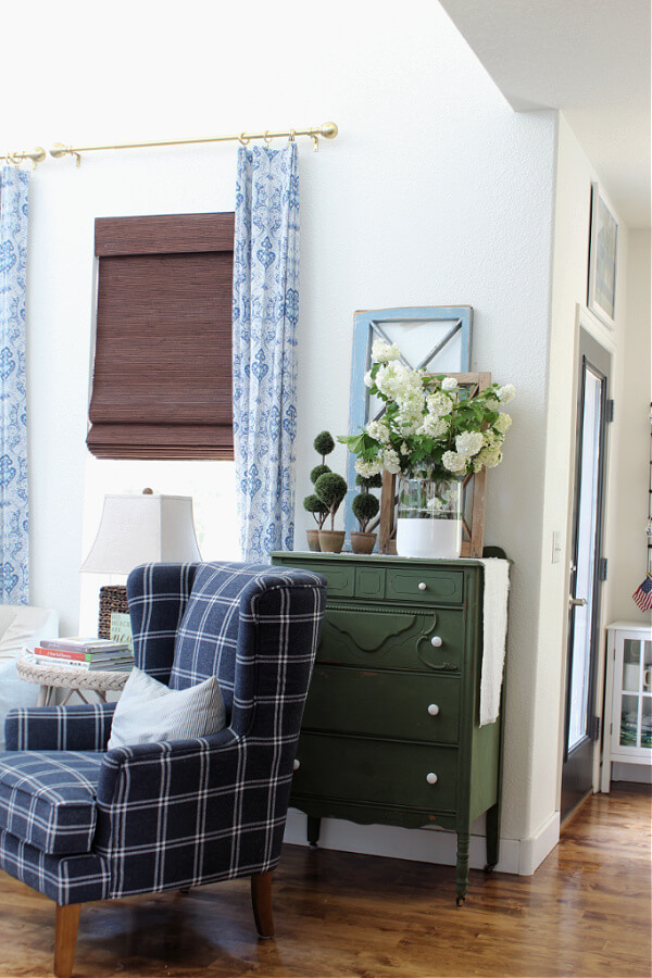Viburnum snowballs, green dressers and blue plaid chairs for summer decor