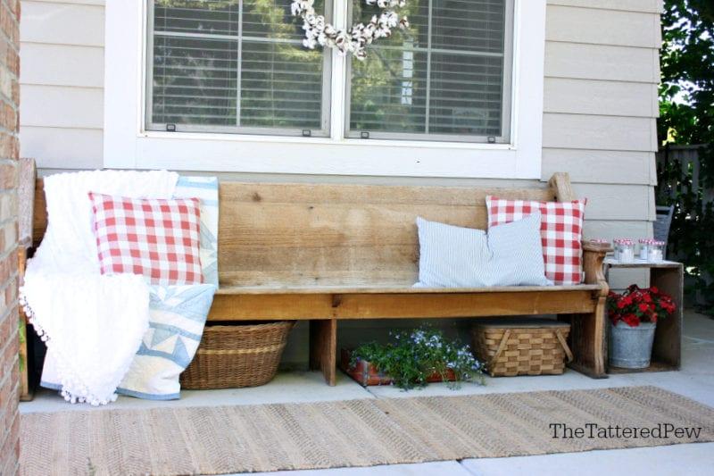 Front porch decor with a patriotic theme.