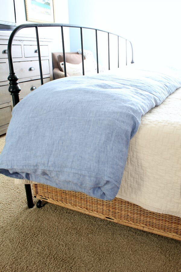 A chambray linen duvet may be a splurge but it well worth it when it come to beachy bedding and comfort!