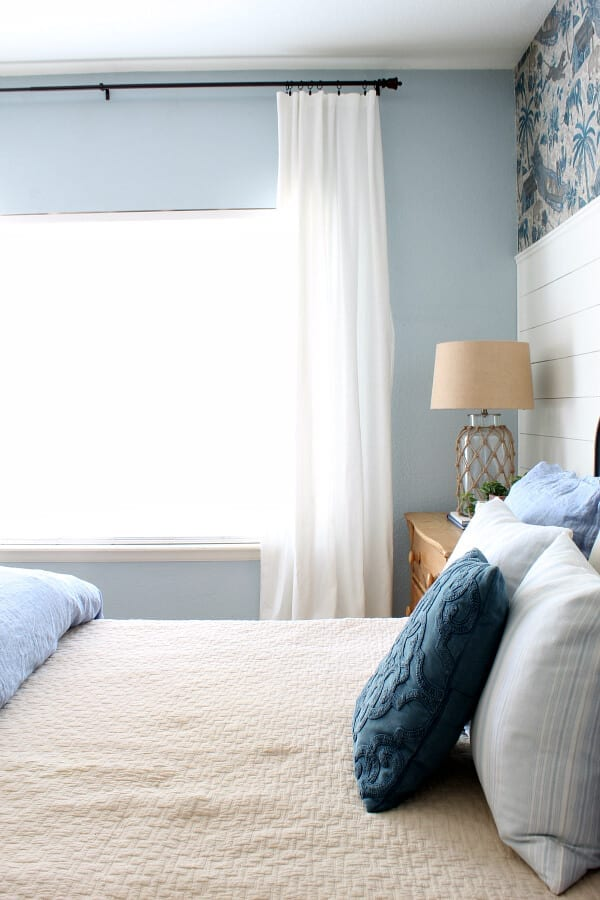 The minute we added these white flowy ceiling height drapes our coastal cottage master bedroom felt complete!