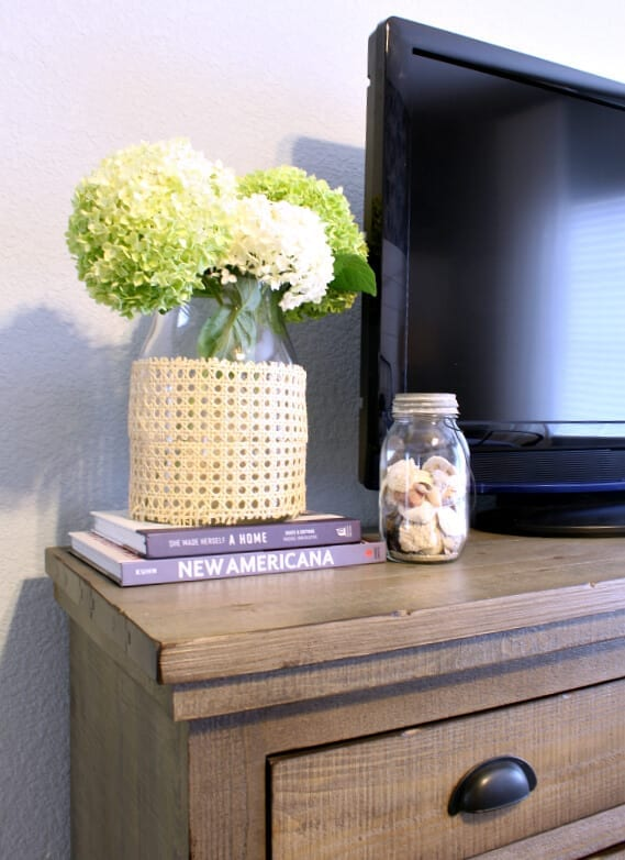 Hydrangeas, shells and a DIY cane vase vignette.
