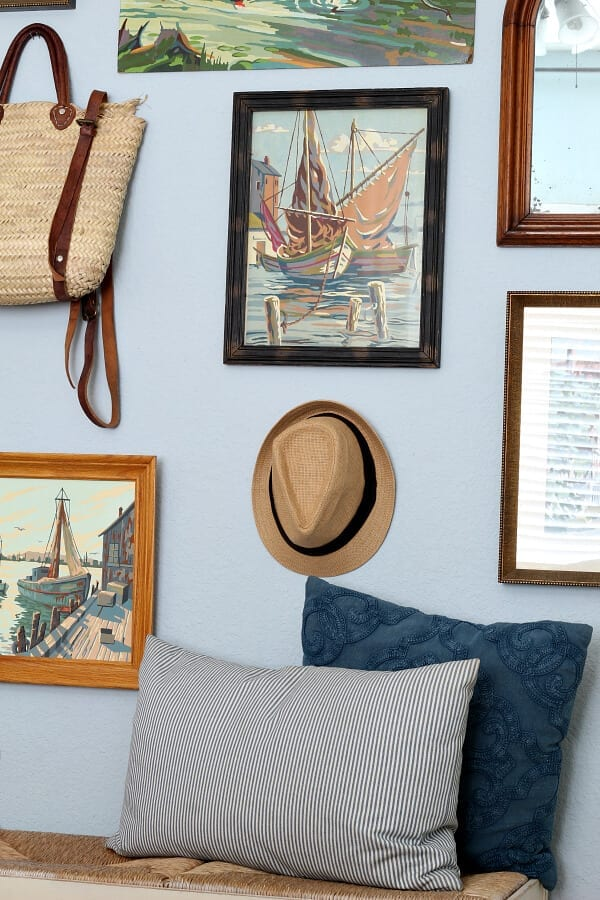 Vintage paint by numbers gallery wall in our bedroom.