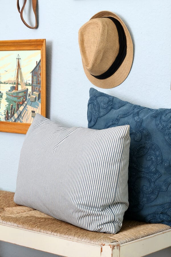 Think outside of the box when creating a bedroom gallery wall!