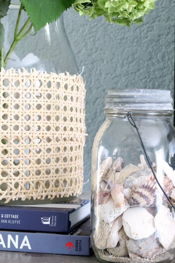 Displaying a personal collection of shells is a great way to decorate with a coastal feel in your bedroom!