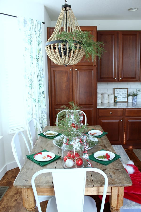 A Christmas table just for the kids! Featuring fresh greenery with plaid and pops of red!