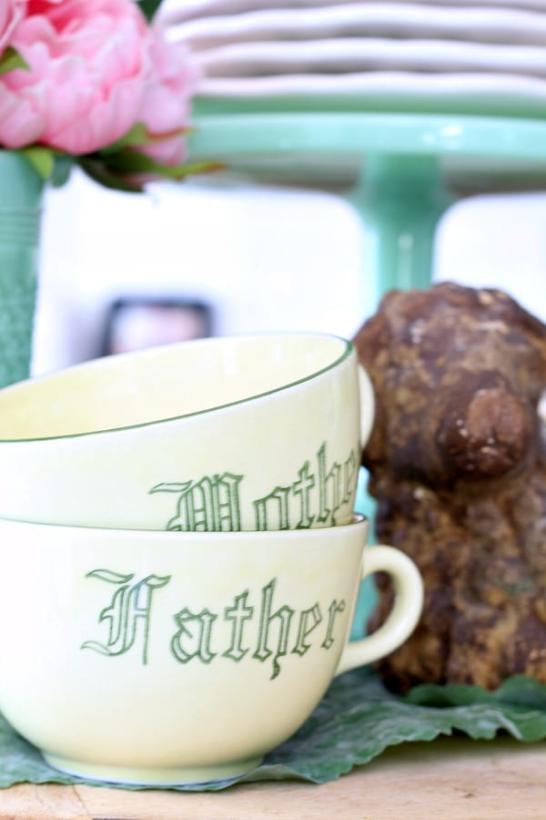 Mother and Father vintage cups on display.