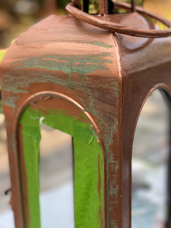 the copper patina starting to show through on my freshly painted lantern.