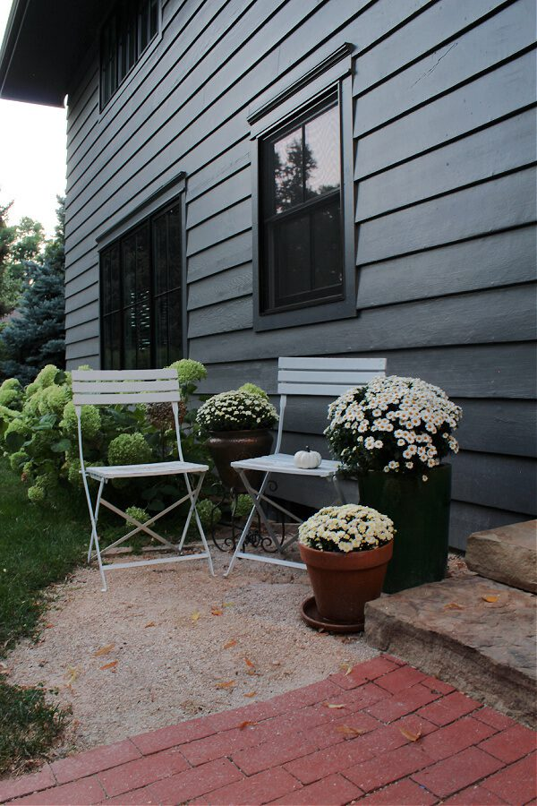 White bistro chairs and mums extend our steps allowing for even more Fall decor in this space.