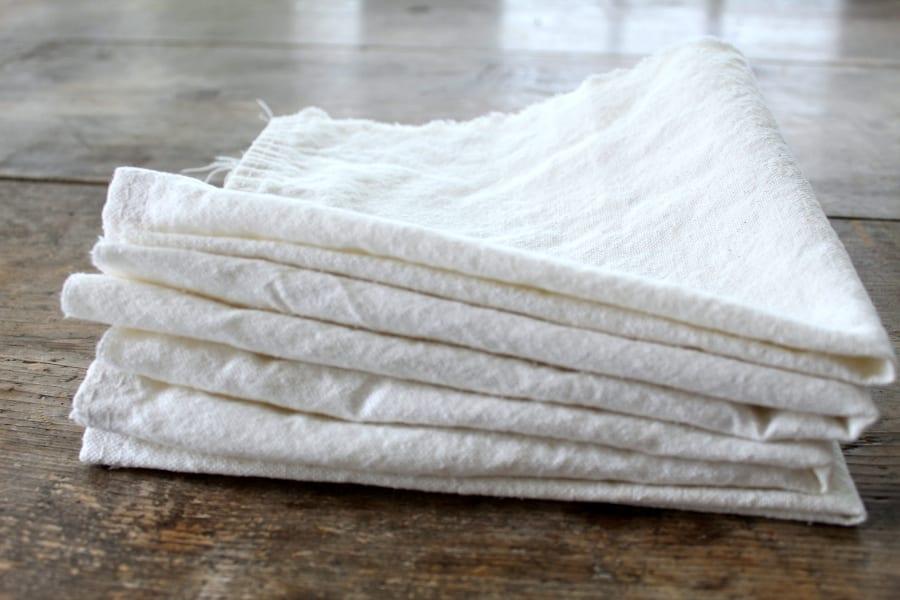 Decide how many no-sew drop cloth napkins you need.